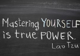 "excerpt from famous Lao Tzu quote ""Mastering others is strength. Mastering yourself is true power."" handwritten on blackboard"